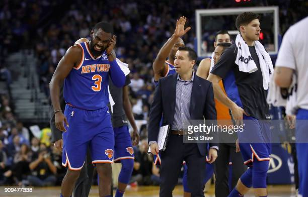 Tim Hardaway Jr #3 of the New York Knicks walks back to the bench during a time out after he collided by teammate Jarrett Jack of the New York Knicks...