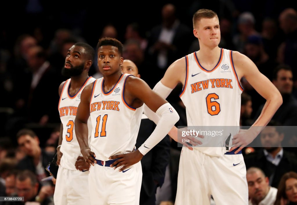 Tim Hardaway Jr. #3,Frank Ntilikina #11 and Kristaps Porzingis #6 of the New York Knicks react in the fourth quarter against the Cleveland Cavaliers at Madison Square Garden on November 13, 2017 in New York City.The Cleveland Cavaliers defeated the New York Knicks 104-101.