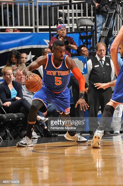 Tim Hardaway Jr #5 of the New York Knicks brings the ball up court against the Orlando Magic on February 11 2015 at Amway Center in Orlando Florida...