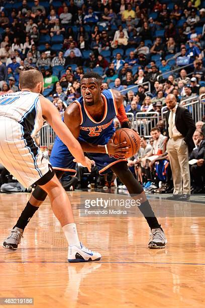 Tim Hardaway Jr #5 of the New York Knicks handles the ball against Evan Fournier of the Orlando Magic on February 11 2015 at Amway Center in Orlando...