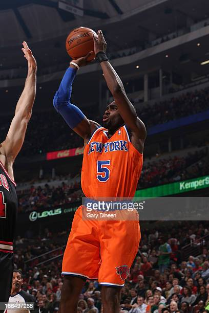 Tim Hardaway Jr #5 of the New York Knicks shoots over Mike Dunleavy of the Chicago Bulls on October 31 2013 at the United Center in Chicago Illinois...
