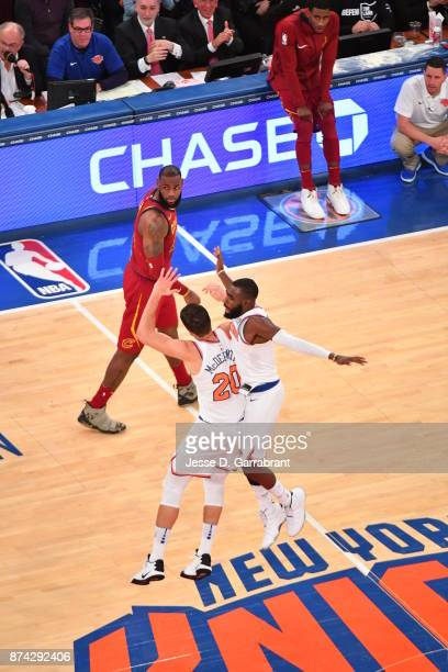 Tim Hardaway Jr of the New York Knicks chest bumps his teammate against the Cleveland Cavaliers at Madison Square Garden on November 13 2017 in New...