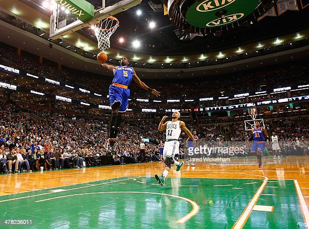Tim Hardaway Jr of the New York Knicks dunks the ball against the Boston Celtics in the second quarter during the game at TD Garden on March 12 2014...