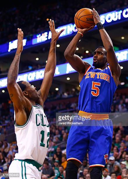 Tim Hardaway Jr of the New York Knicks takes a shot over Chris Johnson of the Boston Celtics in the first half during the game at TD Garden on March...