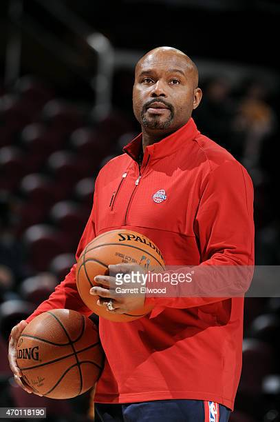 Tim Hardaway of the Detroit Pistons helps the team warm up before a game against the Cleveland Cavaliers on April 13 2015 at Quicken Loans Arena in...