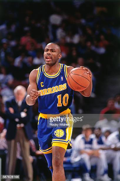 Tim Hardaway of the Golden State Warriors brings the ball up the court during the game against the Sacramento Kings at the Alameda County Coliseum...