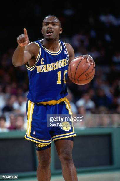 Tim Hardaway of the Golden State Warriors calls for a play against the Milwaukee Bucks during an NBA game at the Bradley Center circa 1991 in...