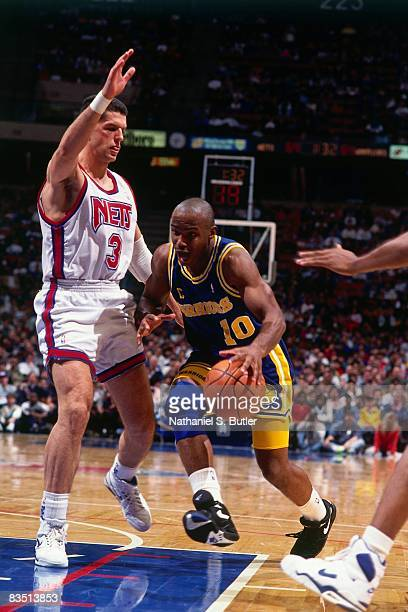 Tim Hardaway of the Golden State Warriors dribbles against Drazen Petrovic of the New Jersey Nets during the 1991 season at the Brendan Byrne Arena...