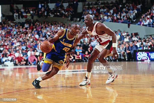 Tim Hardaway of the Golden State Warriors dribbles against Terry Porter of the Portland Trailblazers at the Veterans Memorial Coliseum circa 1993 in...
