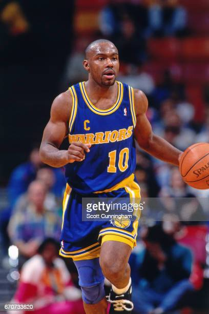 Tim Hardaway of the Golden State Warriors dribbles against the Atlanta Hawks during a game played circa 1990 at the Omni in Atlanta Georgia NOTE TO...
