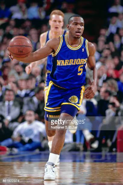 Tim Hardaway of the Golden State Warriors dribbles against the New York Knicks during a game played circa 1990 at Madison Square Garden in New York...