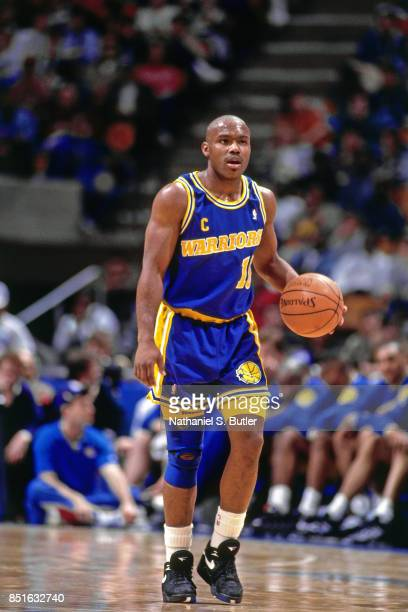 Tim Hardaway of the Golden State Warriors dribbles against the New Jersey Nets circa 1991 at the Brendan Byrne Arena in East Rutherford New Jersey...