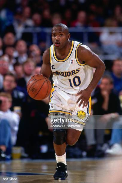 Tim Hardaway of the Golden State Warriors dribbles during a game played in 1991 at the Oakland Coliseum in Oakland California NOTE TO USER User...