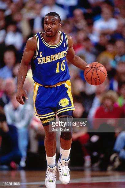 Tim Hardaway of the Golden State Warriors dribbles the ball against the Portland Trail Blazers during a game played at the Veterans Memorial Coliseum...