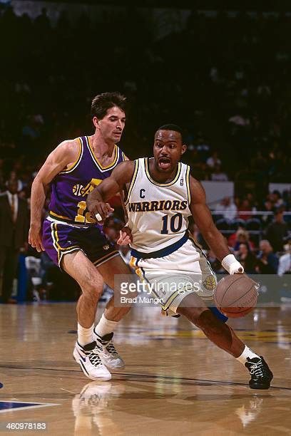 Tim Hardaway of the Golden State Warriors dribbles the ball against the Utah Jazz during a game played circa 1995 at the Oakland Coliseum in Oakland...