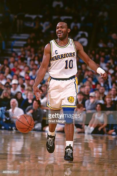 Tim Hardaway of the Golden State Warriors dribbles the ball during a game played circa 1995 at the Oakland Coliseum in Oakland California NOTE TO...