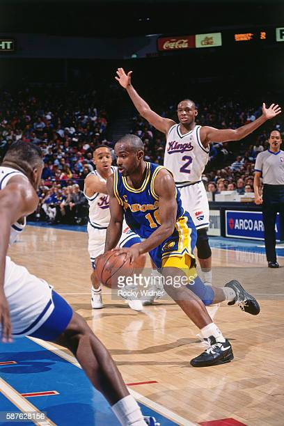 Tim Hardaway of the Golden State Warriors dribbles the ball during the game against the Sacramento Kings at the Alameda County Coliseum Arena in...