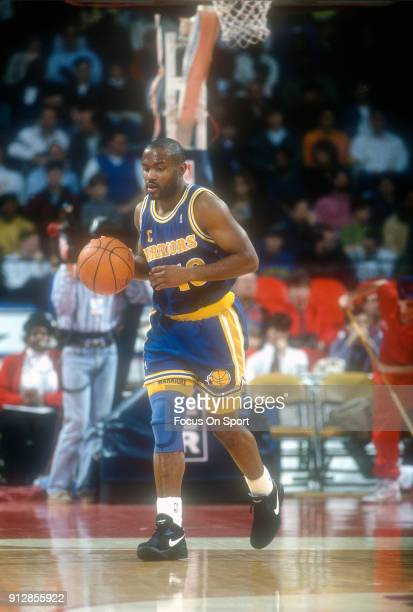 Tim Hardaway of the Golden State Warriors dribbles the ball up court against the Washington Bullets during an NBA basketball game circa 1993 at the...