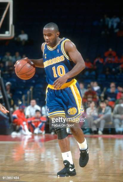 Tim Hardaway of the Golden State Warriors dribbles the ball up court against the Washington Bullets during an NBA basketball game circa 1992 at the...