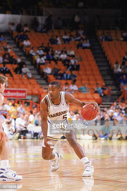 Tim Hardaway of the Golden State Warriors drives during an NBA game in the 198990 season NOTE TO USER User expressly acknowledges and agrees that by...