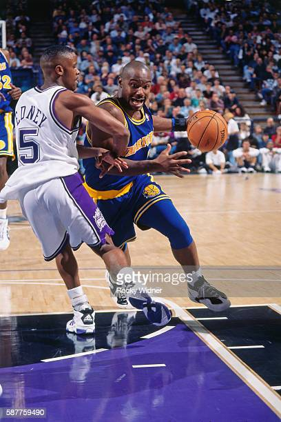 Tim Hardaway of the Golden State Warriors drives to the basket against the Sacramento Kings circa 1996 at Arco Arena in Sacramento California NOTE TO...