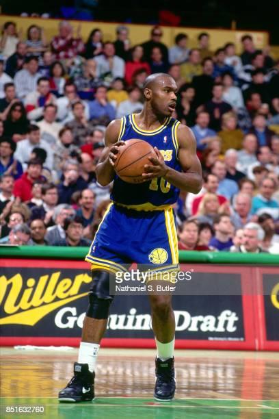 Tim Hardaway of the Golden State Warriors handles the ball against the Boston Celtics circa 1991 at the Boston Garden in Boston Massachusetts NOTE TO...
