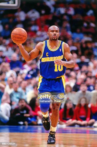 Tim Hardaway of the Golden State Warriors handles the ball during the game against the New Jersey Nets circa 1993 at the Brendan Byrne Arena in East...