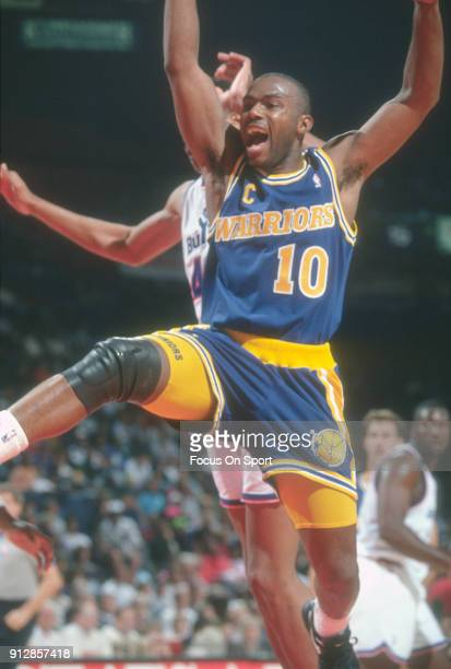Tim Hardaway of the Golden State Warriors in action against the Washington Bullets during an NBA basketball game circa 1992 at the Capital Centre in...