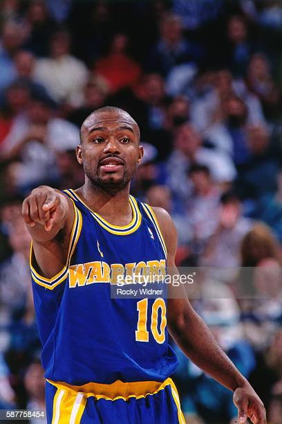 Tim Hardaway of the Golden State Warriors looks on against the Sacramento Kings circa 1995 at Arco Arena in Sacramento California NOTE TO USER User...