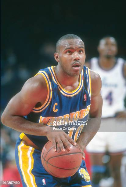 Tim Hardaway of the Golden State Warriors shoots a free throw against the Washington Bullets during an NBA basketball game circa 1992 at the Capital...
