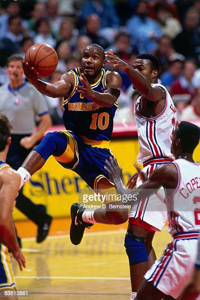 Tim Hardaway of the Golden State Warriors shoots against Los Angeles Clippers during the 1991 season at the Oakland Coliseum in Oakland California...
