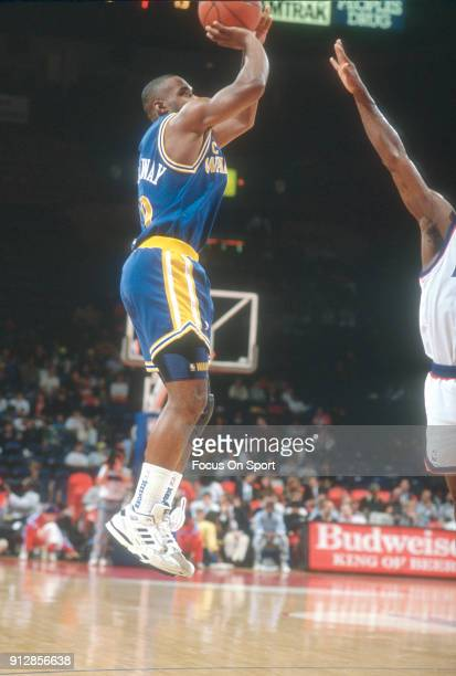 Tim Hardaway of the Golden State Warriors shoots against the Washington Bullets during an NBA basketball game circa 1990 at the Capital Centre in...