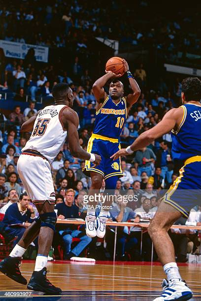Tim Hardaway of the Golden State Warriors shoots the ball during a game played circa 1996 at OaklandAlameda County Coliseum in Oakland California...