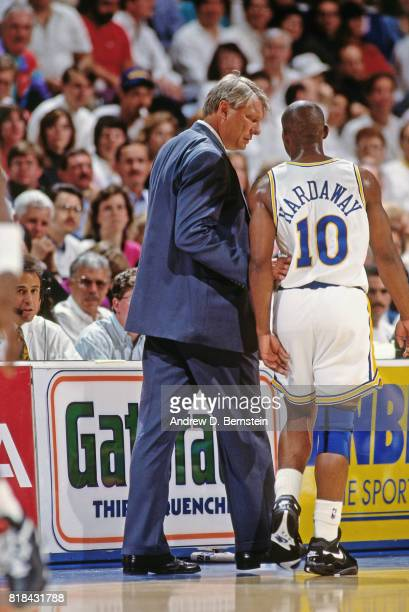 Tim Hardaway of the Golden State Warriors talks with coach Don Nelson during a game at OaklandAlameda County Coliseum Arena in Oakland California...