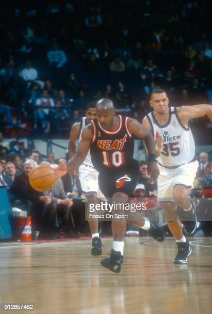 Tim Hardaway of the Miami Heat dribbles the ball up court against the Washington Bullets during an NBA basketball game circa 1997 at the US Airways...