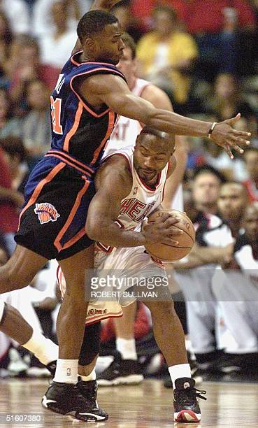 Tim Hardaway of the Miami Heat is guarded by Charlie Ward of the New York Knicks in first half action 16 May during game five of their 1st round...