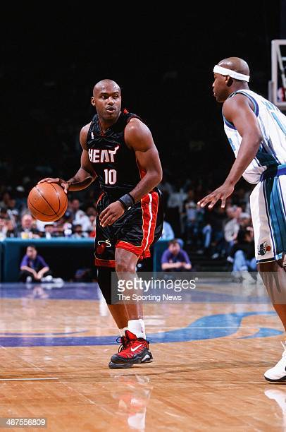 Tim Hardaway of the Miami Heat moves the ball during the game against the Charlotte Hornets on February 20 2000 at Charlotte Coliseum in Charlotte...