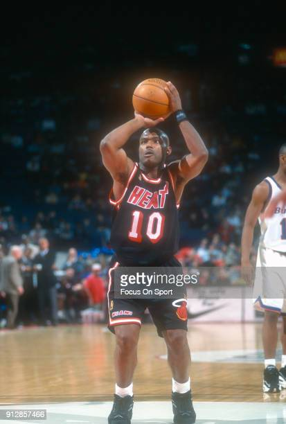 Tim Hardaway of the Miami Heat shoots a free throw against the Washington Bullets during an NBA basketball game circa 1997 at the US Airways Arena in...