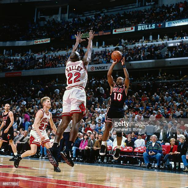 Tim Hardaway of the Miami Heat shoots a jump shot over John Salley of the Chicago Bulls in Game One of the Eastern Conference Quarterfinals during...