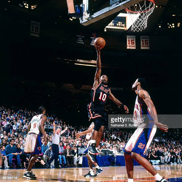 Tim Hardaway of the Miami Heat shoots a layup against Marcus Camby of the New York Knicks in Game Four of the Eastern Conference Quarterfinals during...