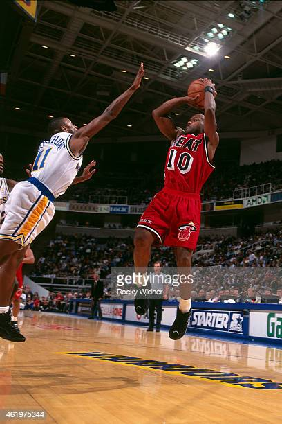 Tim Hardaway of the Miami Heat shoots against the Golden State Warriors on November 26 1996 at the Oakland Coliseum in Oakland California NOTE TO...
