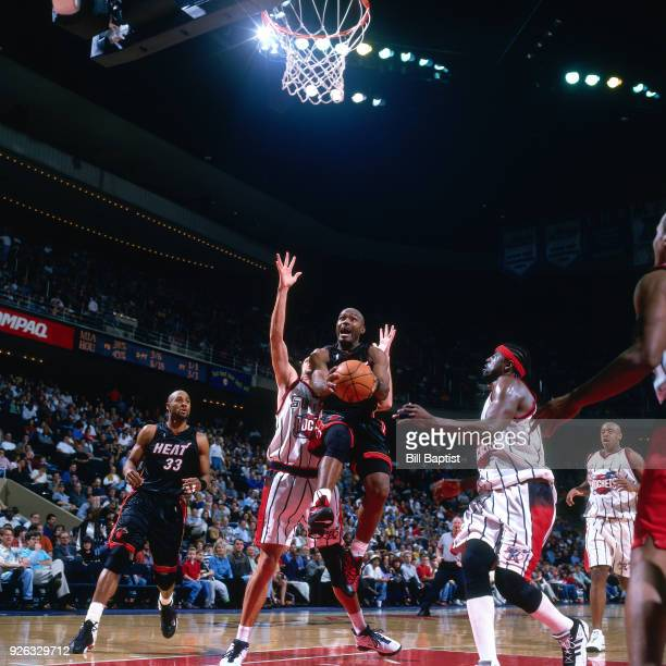 Tim Hardaway of the Miami Heat shoots during a game played circa 2000 at the Compaq Center in Houston Texas NOTE TO USER User expressly acknowledges...