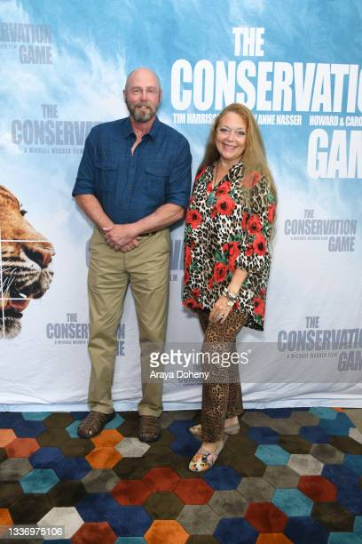 """Tim Harrison and Carole Baskin attend the Los Angeles theatrical premiere of """"The Conservation Game"""" on August 28, 2021 in Santa Monica, California."""