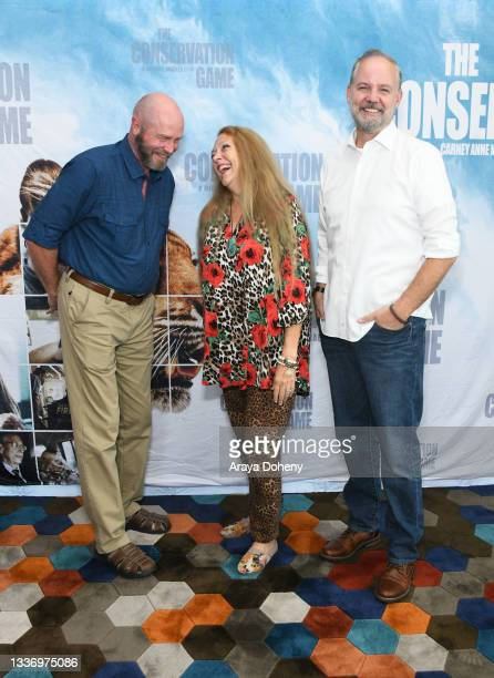 """Tim Harrison, Carole Baskin and Michael Webber attend the Los Angeles theatrical premiere of """"The Conservation Game"""" on August 28, 2021 in Santa..."""