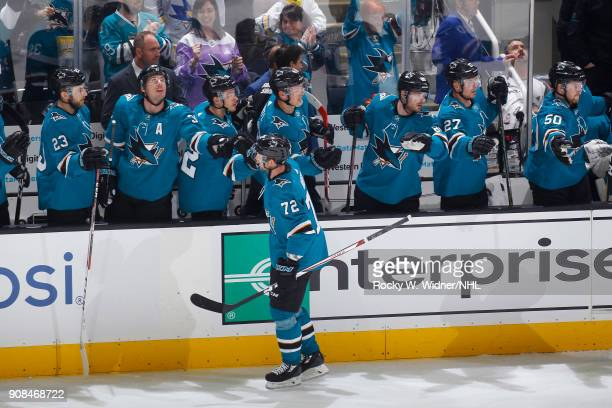 Tim Heed of the San Jose Sharks high fives teammates during the game against the Arizona Coyotes at SAP Center on January 13 2018 in San Jose...