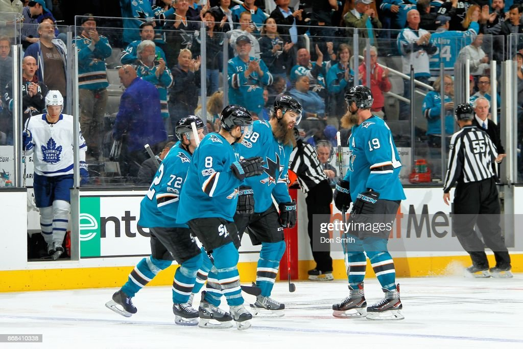 Tim Heed #72 of the San Jose Sharks skates away with teammates after celebrating Heed's third period goal during a NHL game against the Toronto Maple Leafs at SAP Center on October 30, 2017 in San Jose, California.