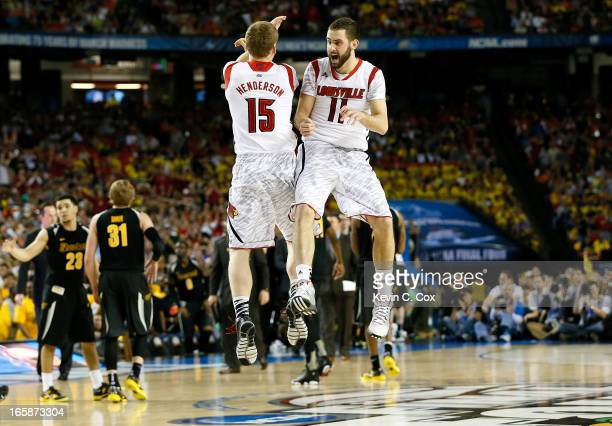 Tim Henderson and Luke Hancock of the Louisville Cardinals celebrate late in the second half while taking on the Wichita State Shockers during the...