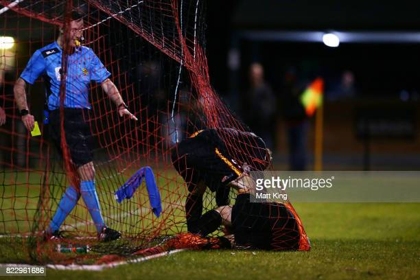 Tim Henderson of the MetroStars attempts to take the ball from Bankstown Berries goalkeeper Chad Taylor after the goal to Matthew Dawber of the...