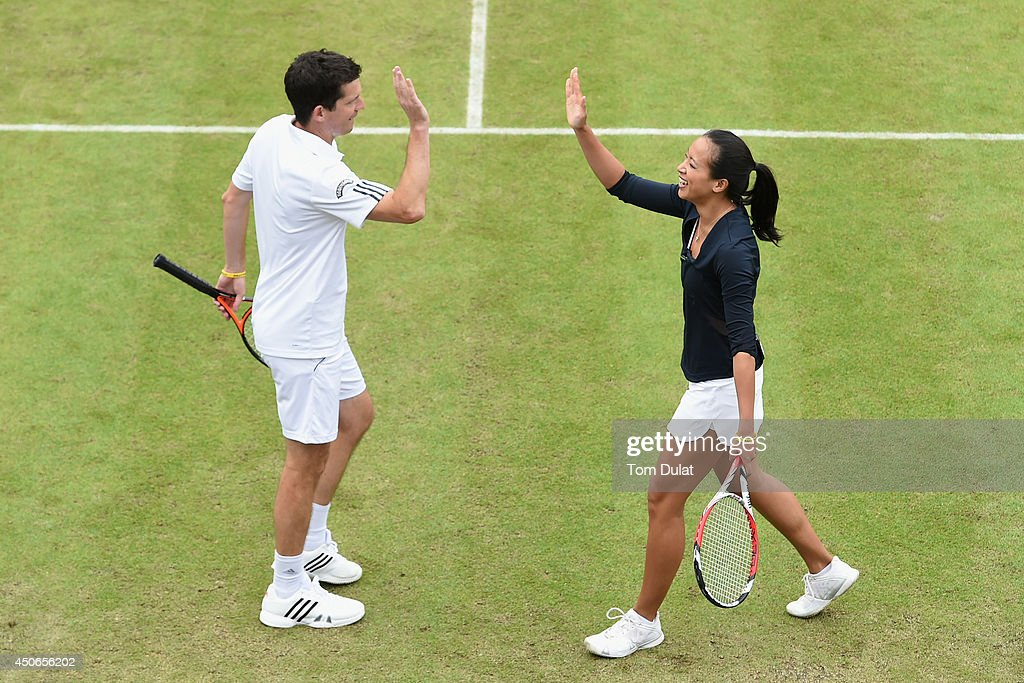 Tim Henman and Anne Keothavong of England take part in an exhibition match to honour the late Elena Baltacha during Day Seven of the Aegon Classic at Edgbaston Priory Club on June 15, 2014 in Birmingham, England.