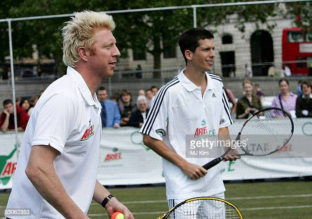 Tim Henman and Boris Becker in action at the Ariel Celebrity Tennis Match held in Trafalgar Square on June 13 2005 in London England